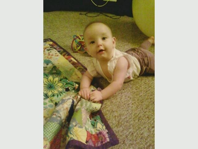 Sydnee with her quilt